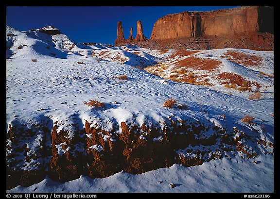 Snow on the floor, with Three Sisters in the background. Monument Valley Tribal Park, Navajo Nation, Arizona and Utah, USA (color)