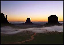 Mittens and fog, sunrise. Monument Valley Tribal Park, Navajo Nation, Arizona and Utah, USA (color)
