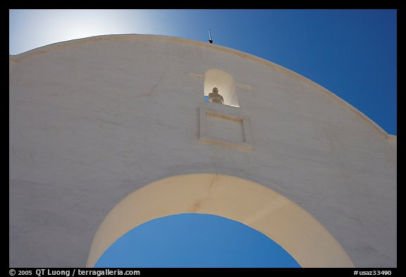 Backlit whitewashed arch, San Xavier del Bac Mission. Tucson, Arizona, USA