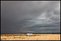 Trailer and storm sky. Arizona, USA
