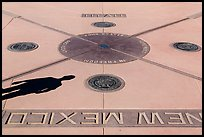 Shadow and state seals. Four Corners Monument, Arizona, USA (color)