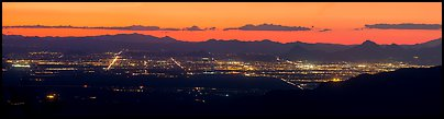 Tucson lights at sunset from Rincon Mountains. Tucson, Arizona, USA (Panoramic color)