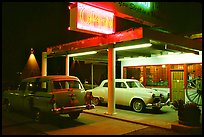Old American cars in front of motel, Holbrook. Arizona, USA (color)