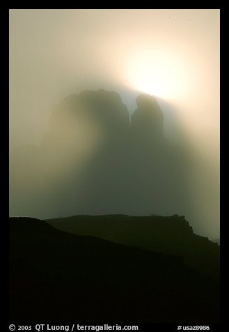 Butte in fog. Monument Valley Tribal Park, Navajo Nation, Arizona and Utah, USA