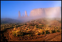 Three sisters, clearing fog, morning. Monument Valley Tribal Park, Navajo Nation, Arizona and Utah, USA