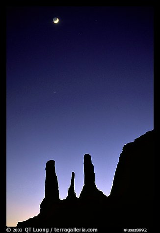 Three sisters and moon, dusk. Monument Valley Tribal Park, Navajo Nation, Arizona and Utah, USA (color)