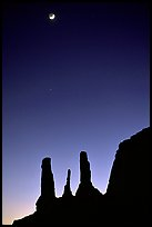Three sisters and moon, dusk. Monument Valley Tribal Park, Navajo Nation, Arizona and Utah, USA ( color)