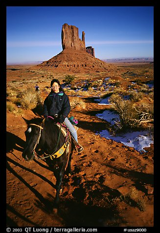 Horseback riding. Monument Valley Tribal Park, Navajo Nation, Arizona and Utah, USA (color)
