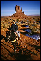 Horseback riding. Monument Valley Tribal Park, Navajo Nation, Arizona and Utah, USA
