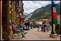 Men sitting on main street sidewalk. Telluride, Colorado, USA ( color)