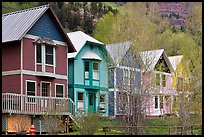 Houses with pastel colors and newly leafed trees. Telluride, Colorado, USA ( color)