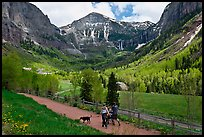 Family hiking on trail towards Bridalveil Falls in the spring. Telluride, Colorado, USA