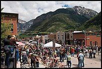 Crowds gather on main street during ice-cream social. Telluride, Colorado, USA ( color)