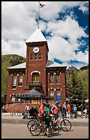 Mountain bikers in front of San Miguel County court house. Telluride, Colorado, USA (color)
