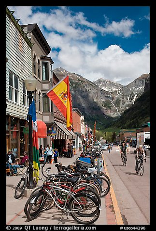 Mountain bikes parked on main street sidewalk. Telluride, Colorado, USA (color)
