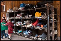 Family tries out clothes from sharing box. Telluride, Colorado, USA (color)