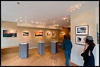 Visitors in art gallery. Telluride, Colorado, USA (color)