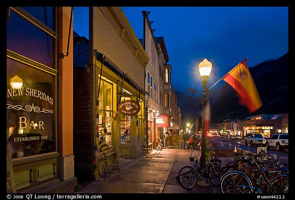Street with parked bicycles and lamp by night. Telluride, Colorado, USA