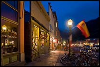 Street with parked bicycles and lamp by night. Telluride, Colorado, USA ( color)