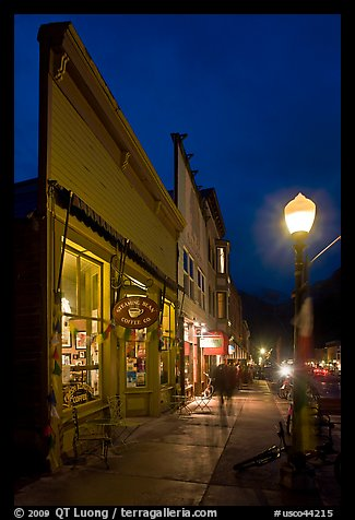 Coffee shop and sidewalk by night. Telluride, Colorado, USA