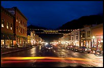 Colorado Street by night with Mountainfilm banner. Telluride, Colorado, USA (color)