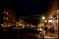 People walking by store on Colorado Street by night. Telluride, Colorado, USA ( color)