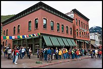 Festival attendees line up on sidewalk. Telluride, Colorado, USA