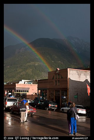 People watching double rainbow on main street. Telluride, Colorado, USA (color)