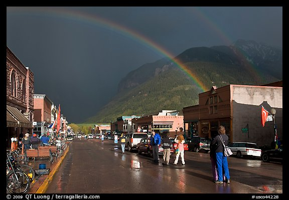 Double rainbow and dark sky over main street. Telluride, Colorado, USA