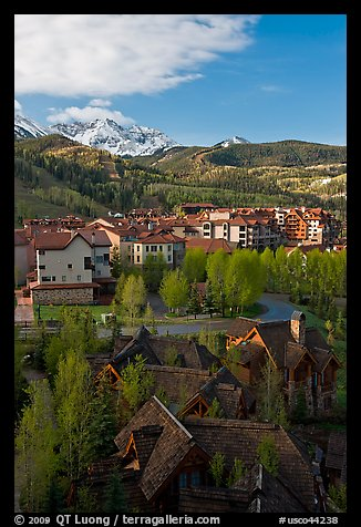 Mountain Village with newly leafed spring trees and snowy peaks. Telluride, Colorado, USA (color)