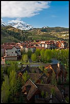 Mountain Village with newly leafed spring trees and snowy peaks. Telluride, Colorado, USA ( color)