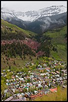 Town, waterfall, and snowy mountains in spring. Telluride, Colorado, USA ( color)