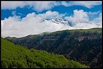 Snowy Mt Wilson emerging from clouds in the spring. Colorado, USA