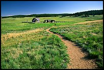 Trail and historic barns,  Florissant Fossil Beds National Monument. Colorado, USA (color)