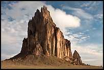 Shiprock with top embraced by cloud. Shiprock, New Mexico, USA