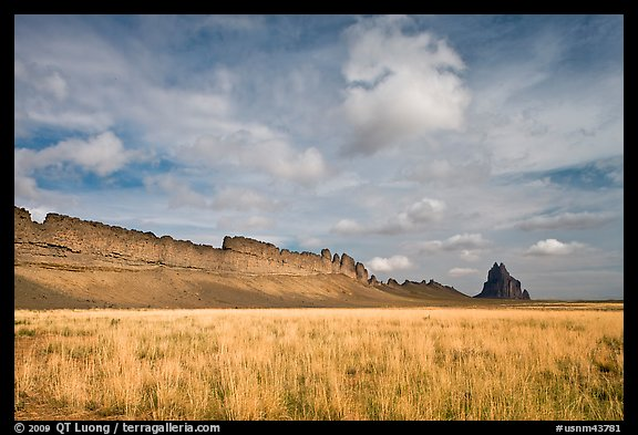Serrated volcanic ridge leading to Shiprock. Shiprock, New Mexico, USA (color)