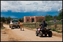Rural road on the reservation with ATV, truck and horse. Taos, New Mexico, USA (color)