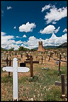 Wooden crosses and old adobe church. Taos, New Mexico, USA ( color)