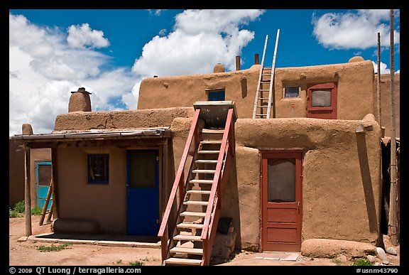 Multi-story pueblo houses with ladders. Taos, New Mexico, USA (color)