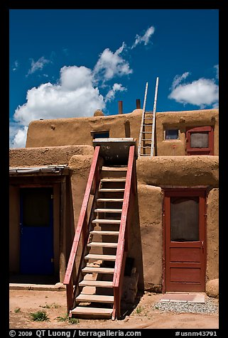 Ladder used to access upper floor of pueblo. Taos, New Mexico, USA (color)
