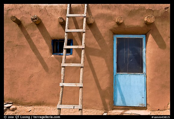 Ladder on adobe facade. Taos, New Mexico, USA