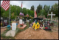Headstones, tombs and american flags. Taos, New Mexico, USA