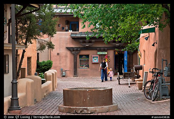 Pedestrian alley with woman and child. Taos, New Mexico, USA (color)
