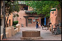 Pedestrian alley with woman and child. Taos, New Mexico, USA ( color)