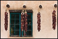 Yellow wall with ristras and blue window. Taos, New Mexico, USA ( color)