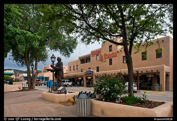 Plazza, statue, and hotel La Fonda. Taos, New Mexico, USA (color)
