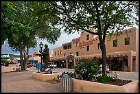 Plazza, statue, and hotel La Fonda. Taos, New Mexico, USA