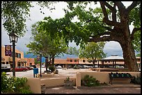 Plazza, trees and buildings in adobe style. Taos, New Mexico, USA ( color)