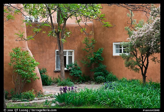 Garden and pueblo revival style building. Taos, New Mexico, USA