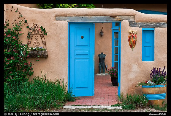 Adobe style walls, blue doors and windows, and courtyard. Taos, New Mexico, USA